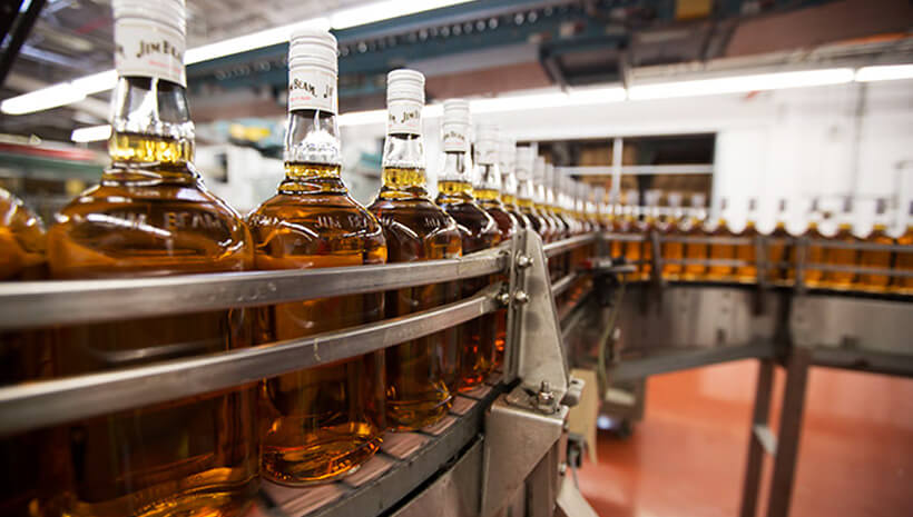 Jim Beam bottles on a conveyer band.