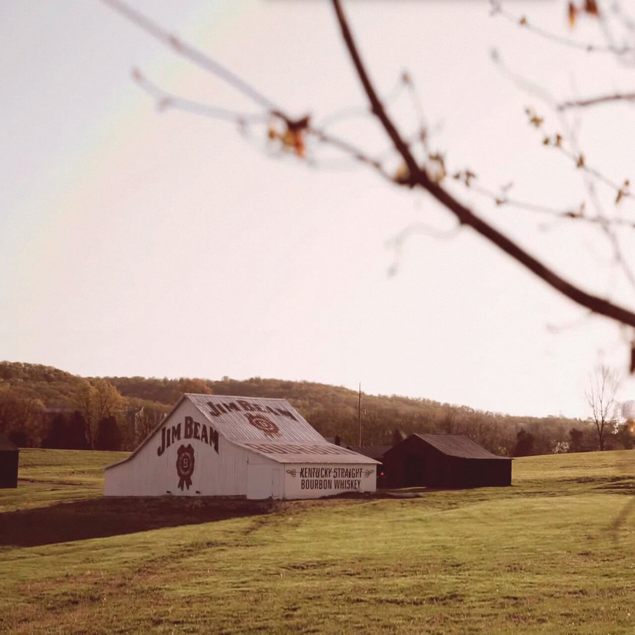 The Jim Beam American Stillhouse surrounded by beautiful Kentucky landscape.